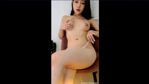 Beautiful Korean girl enjoys self-massage her breasts