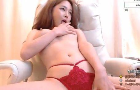 Gorgeous Korean woman masturbating on a gaming chair