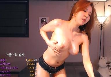 Korean lady masturbating with massage oil