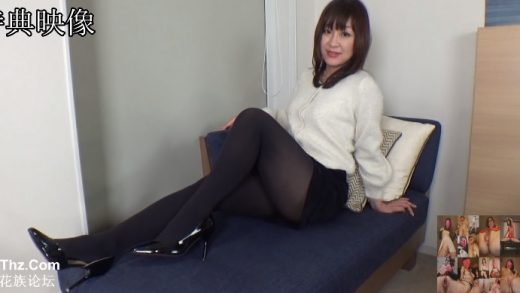 Charming Japan girl in miniskirt and tight-fitting mesh stockings